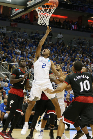Mar 21, 2015; Louisville, KY, USA; Kentucky Wildcats guard Aaron Harrison (2) shoots the ball against the Cincinnati Bearcats during the second half in the third round of the 2015 NCAA Tournament  ...
