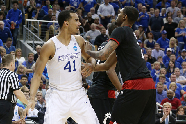 Mar 21, 2015; Louisville, KY, USA; Kentucky Wildcats forward Trey Lyles (41) and Cincinnati Bearcats forward Octavius Ellis (2) scuffle after the whistle during the second half in the third round  ...