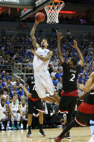 Mar 21, 2015; Louisville, KY, USA; Kentucky Wildcats forward Willie Cauley-Stein (15) shoots the ball against the Cincinnati Bearcats during the second half in the third round of the 2015 NCAA Tou ...