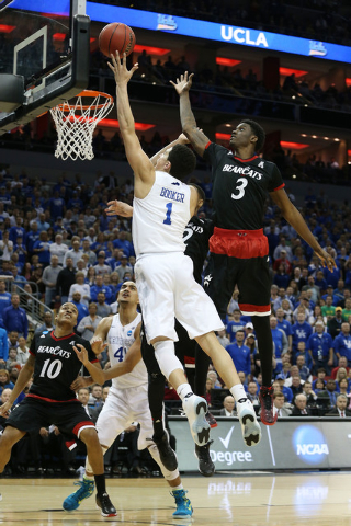 Mar 21, 2015; Louisville, KY, USA; Kentucky Wildcats guard Devin Booker (1) shoots the ball against Cincinnati Bearcats forward Shaquille Thomas (3) during the second half in the third round of th ...