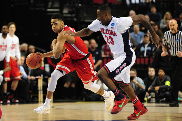 Mar 21, 2015; Portland, OR, USA; Ohio State Buckeyes guard D'Angelo Russell (left) dribbles against Arizona Wildcats forward Rondae Hollis-Jefferson (23) during the first half in the third round o ...