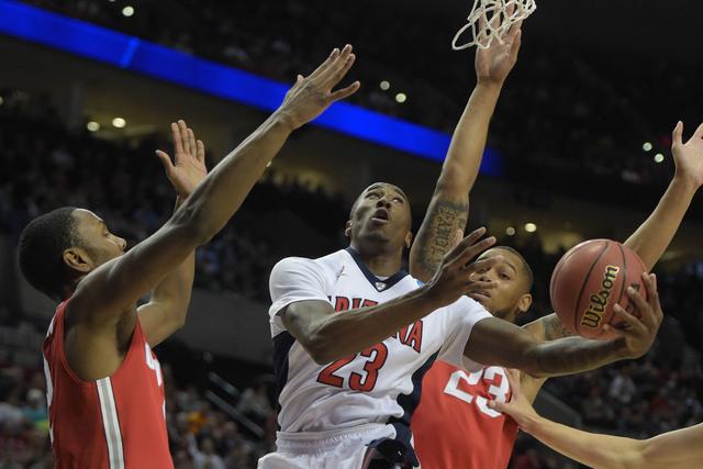Mar 21, 2015; Portland, OR, USA; Arizona Wildcats forward Rondae Hollis-Jefferson (23, center) shots the basketball against Ohio State Buckeyes forward Sam Thompson (left) and center Amir Williams ...