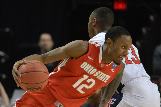 Mar 21, 2015; Portland, OR, USA; Ohio State Buckeyes forward Sam Thompson (12) dribbles the basketball against Arizona Wildcats forward Rondae Hollis-Jefferson (23) during the first half in the th ...
