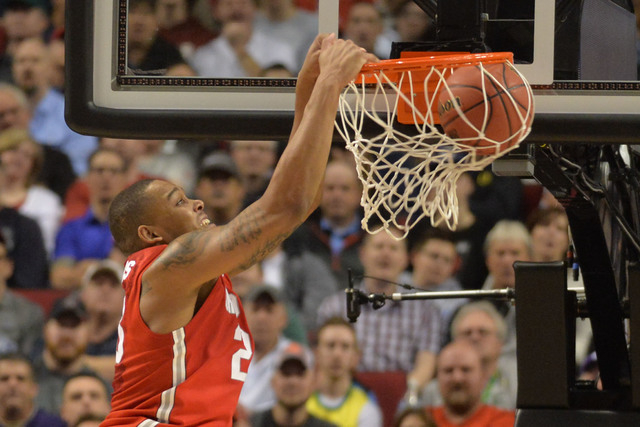 Mar 21, 2015; Portland, OR, USA; Ohio State Buckeyes center Amir Williams (23) dunks the basketball against the Arizona Wildcats during the first half in the third round of the 2015 NCAA Tournamen ...