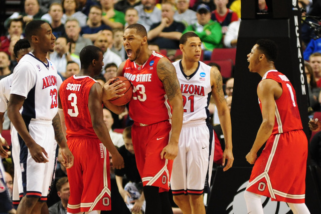 Mar 21, 2015; Portland, OR, USA; Ohio State Buckeyes center Amir Williams (23) celebrates against the Arizona Wildcats during the first half in the third round of the 2015 NCAA Tournament at Moda  ...