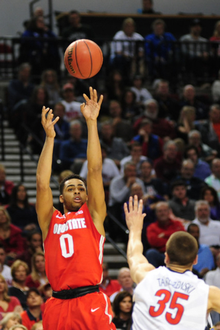 Mar 21, 2015; Portland, OR, USA; Ohio State Buckeyes guard D'Angelo Russell (0) shoots the basketball against Arizona Wildcats center Kaleb Tarczewski (35) during the first half in the third round ...