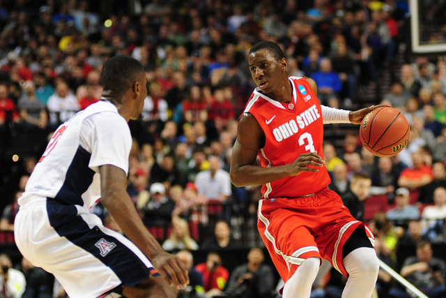 Mar 21, 2015; Portland, OR, USA; Ohio State Buckeyes guard Shannon Scott (3) dribbles the basketball against Arizona Wildcats forward Rondae Hollis-Jefferson (left) during the first half in the th ...
