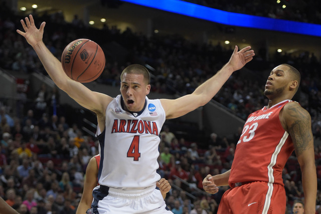 Mar 21, 2015; Portland, OR, USA; Arizona Wildcats guard T.J. McConnell (4) loses the basketball against Ohio State Buckeyes center Amir Williams (23) during the first half in the third round of th ...