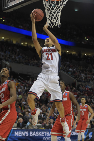 Mar 21, 2015; Portland, OR, USA; Arizona Wildcats forward Brandon Ashley (21) shoots a layup against the Ohio State Buckeyes during the first half in the third round of the 2015 NCAA Tournament at ...