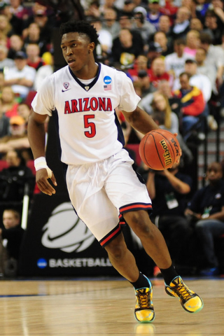 Mar 21, 2015; Portland, OR, USA; Arizona Wildcats forward Stanley Johnson (5) dribbles the basketball against the Ohio State Buckeyes during the second half in the third round of the 2015 NCAA Tou ...