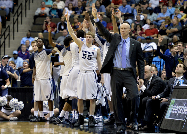 Mar 21, 2015; Jacksonville, FL, USA; The Xavier Musketeers bench reacts against the Georgia State Panthers in the first half of a game in the third round of the 2015 NCAA Tournament at Jacksonvill ...
