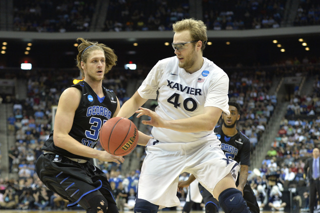 Mar 21, 2015; Jacksonville, FL, USA; Xavier Musketeers center Matt Stainbrook (40) drives against Georgia State Panthers forward T.J. Shipes (31) in the first half of a game in the third round of  ...
