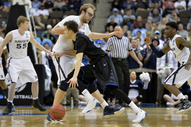 Mar 21, 2015; Jacksonville, FL, USA; Georgia State Panthers guard R.J. Hunter (22) drives against Xavier Musketeers center Matt Stainbrook (40) in the first half of a game in the third round of th ...