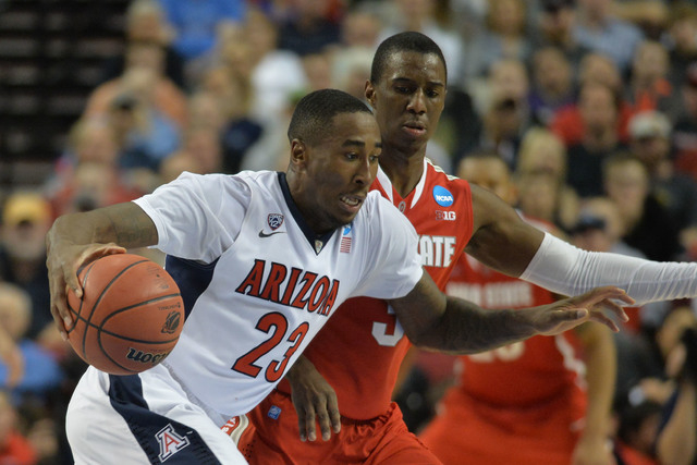 Mar 21, 2015; Portland, OR, USA; Arizona Wildcats forward Rondae Hollis-Jefferson (23) dribbles the basketball against Ohio State Buckeyes guard Shannon Scott (3) during the second half in the thi ...