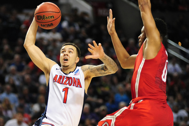 Mar 21, 2015; Portland, OR, USA; Arizona Wildcats guard Gabe York (1) drives to the basket against Ohio State Buckeyes guard D'Angelo Russell (0) during the second half in the third round of the 2 ...