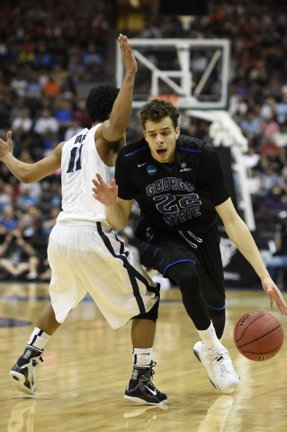 Mar 21, 2015; Jacksonville, FL, USA; Georgia State Panthers guard R.J. Hunter (22) drives around Xavier Musketeers guard Dee Davis (11) in the first half of a game in the third round of the 2015 N ...