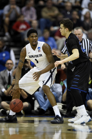 Mar 21, 2015; Jacksonville, FL, USA; Xavier Musketeers forward Jalen Reynolds (1) attempts to drive against Georgia State Panthers guard R.J. Hunter (22) in the first half of a game in the third r ...