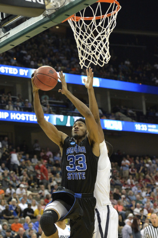 Mar 21, 2015; Jacksonville, FL, USA; Georgia State Panthers forward Markus Crider (33) lays up against the Xavier Musketeers in the second half of a game in the third round of the 2015 NCAA Tourna ...