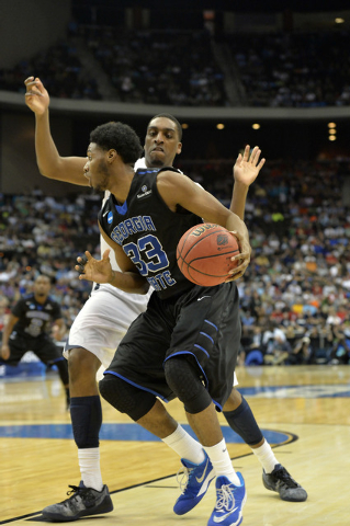 Mar 21, 2015; Jacksonville, FL, USA; Georgia State Panthers forward Markus Crider (33) drives against Xavier Musketeers forward James Farr (2) in the second half of a game in the third round of th ...
