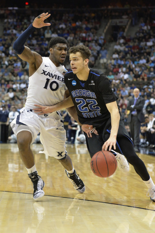 Mar 21, 2015; Jacksonville, FL, USA; Georgia State Panthers guard R.J. Hunter (22) moves to the basket against Xavier Musketeers guard Remy Abell (10) in the second half of a game in the third rou ...