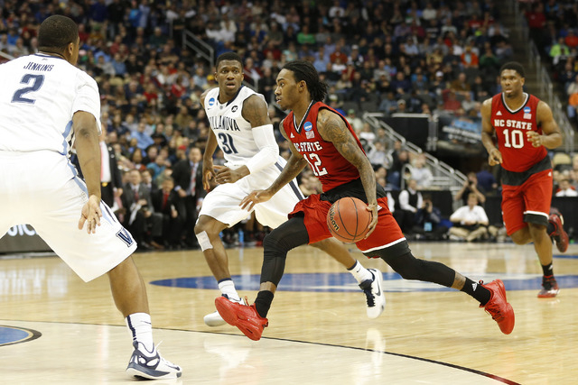 Mar 21, 2015; Pittsburgh, PA, USA; North Carolina State Wolfpack guard Anthony Barber (12) dribbles the ball as Villanova Wildcats guard Dylan Ennis (31) chases in the first half in the third roun ...