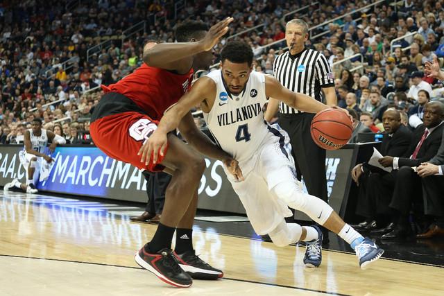 Mar 21, 2015; Pittsburgh, PA, USA; Villanova Wildcats guard Darrun Hilliard II (4) dribbles the ball as North Carolina State Wolfpack forward Abdul-Malik Abu (0) defends during the first half in t ...