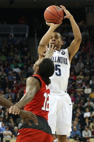 Mar 21, 2015; Pittsburgh, PA, USA; Villanova Wildcats guard Phil Booth (5) shoots the ball over North Carolina State Wolfpack guard Anthony Barber (12) during the first half in the third round of  ...