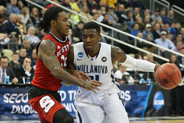 Mar 21, 2015; Pittsburgh, PA, USA; Villanova Wildcats guard Dylan Ennis (31) dribbles the ball as North Carolina State Wolfpack guard Anthony Barber (12) defends during the first half in the third ...
