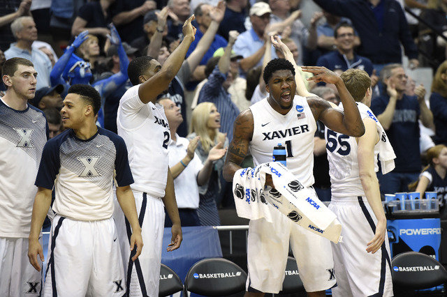 Mar 21, 2015; Jacksonville, FL, USA; Xavier Musketeers forward Jalen Reynolds (1) reacts from the bench against the Georgia State Panthers in the second half of a game in the third round of the 20 ...