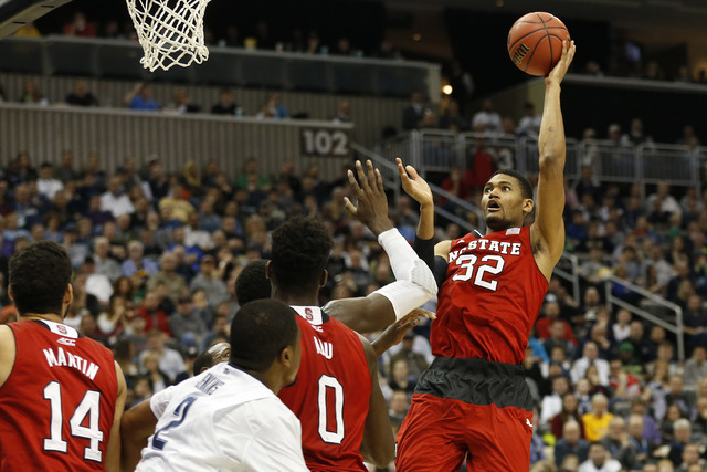 Mar 21, 2015; Pittsburgh, PA, USA; North Carolina State Wolfpack forward Kyle Washington (32) shoots the ball against the Villanova Wildcats in the first half in the third round of the 2015 NCAA T ...