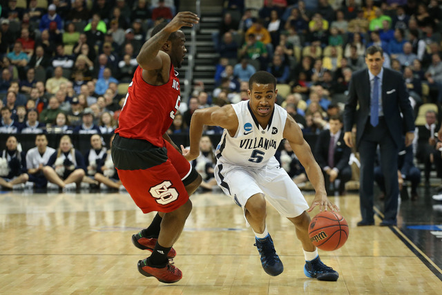 Mar 21, 2015; Pittsburgh, PA, USA; Villanova Wildcats guard Phil Booth (5) dribbles the ball as North Carolina State Wolfpack guard Desmond Lee (5) defends during the first half in the third round ...