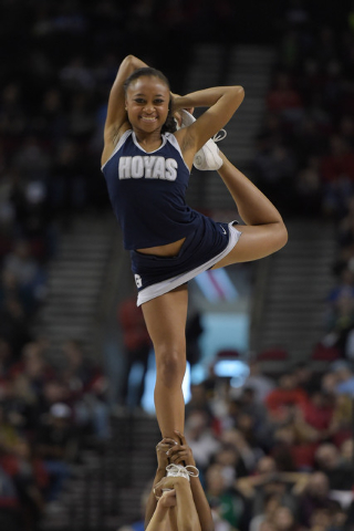Mar 21, 2015; Portland, OR, USA; Georgetown Hoyas cheerleaders perform against the Utah Utes during the first half in the third round of the 2015 NCAA Tournament at Moda Center. (Kirby Lee-USA TOD ...