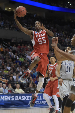 Mar 21, 2015; Portland, OR, USA; Utah Utes guard Delon Wright (55) shoots a layup against the Georgetown Hoyas during the first half in the third round of the 2015 NCAA Tournament at Moda Center.  ...