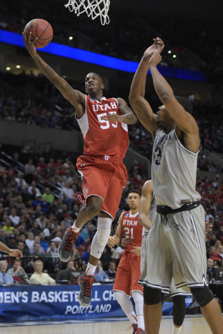 Mar 21, 2015; Portland, OR, USA; Utah Utes guard Delon Wright (55) shoots a layup against Georgetown Hoyas forward Mikael Hopkins (3) during the first half in the third round of the 2015 NCAA Tour ...