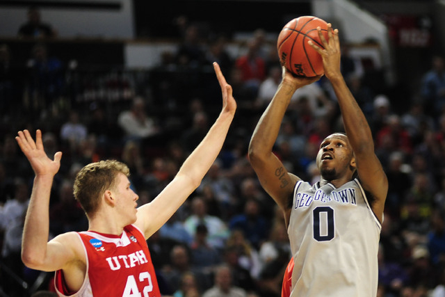 Mar 21, 2015; Portland, OR, USA; Georgetown Hoyas center L.J. Peak (0) shoots the basketball against Utah Utes forward Jakob Poeltl (42) during the first half in the third round of the 2015 NCAA T ...