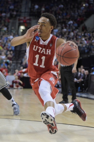 Mar 21, 2015; Portland, OR, USA; Utah Utes guard Brandon Taylor (11) dribbles the basketball against the Georgetown Hoyas during the first half in the third round of the 2015 NCAA Tournament at Mo ...