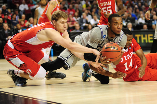 Mar 21, 2015; Portland, OR, USA; Georgetown Hoyas guard Jabril Trawick (center) fights for the basketball against Utah Utes center Dallin Bachynski (left) and guard/forward Dakarai Tucker (14) dur ...