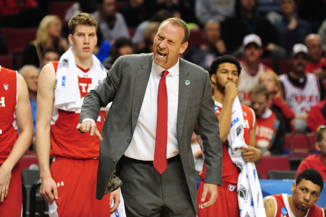 Mar 21, 2015; Portland, OR, USA; Utah Utes head coach Larry Krystkowiak instructs against the Georgetown Hoyas during the first half in the third round of the 2015 NCAA Tournament at Moda Center.  ...