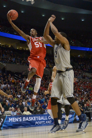 Mar 21, 2015; Portland, OR, USA; Utah Utes guard Delon Wright (55) shoots a layup against Georgetown Hoyas forward Mikael Hopkins (3) during the second half in the third round of the 2015 NCAA Tou ...