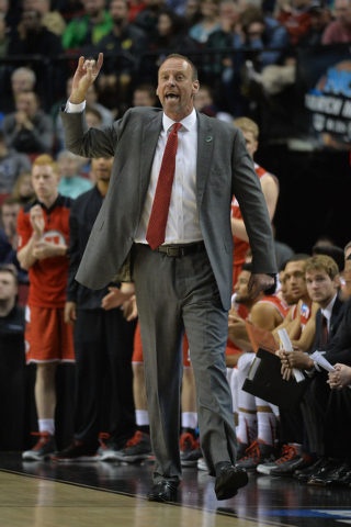 Mar 21, 2015; Portland, OR, USA; Utah Utes head coach Larry Krystkowiak instructs against the Georgetown Hoyas during the second half in the third round of the 2015 NCAA Tournament at Moda Center. ...