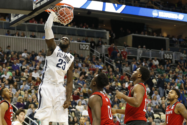 Mar 21, 2015; Pittsburgh, PA, USA; Villanova Wildcats forward Daniel Ochefu (23) dunks the ball in front of North Carolina State Wolfpack forward Abdul-Malik Abu (0) during the second half in the  ...