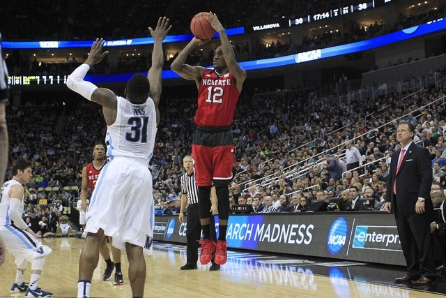 Mar 21, 2015; Pittsburgh, PA, USA; North Carolina State Wolfpack guard Anthony Barber (12) shoots the ball over Villanova Wildcats guard Dylan Ennis (31) during the second half in the third round  ...