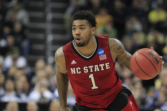 Mar 21, 2015; Pittsburgh, PA, USA; North Carolina State Wolfpack guard Trevor Lacey (1) dribbles the ball against the Villanova Wildcats during the second half in the third round of the 2015 NCAA  ...