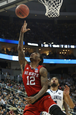 Mar 21, 2015; Pittsburgh, PA, USA; North Carolina State Wolfpack guard Anthony Barber (12) shoots the ball past Villanova Wildcats guard Darrun Hilliard II (4) during the second half in the third  ...