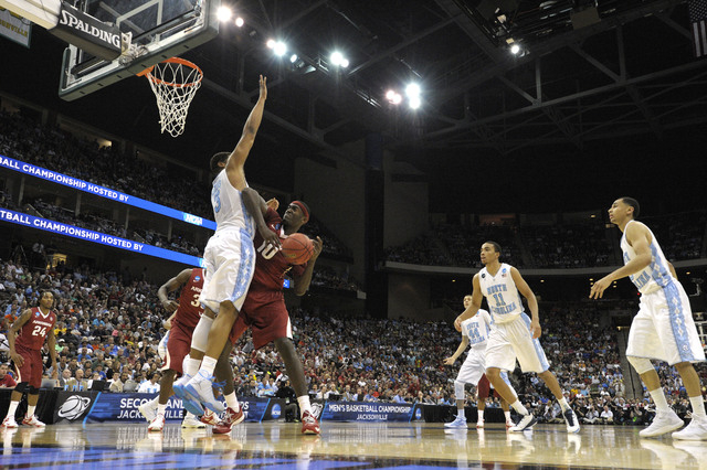 Mar 21, 2015; Jacksonville, FL, USA; Arkansas Razorbacks forward Bobby Portis (10) loses the ball as he tries to drive to the basket against North Carolina Tar Heels forward Kennedy Meeks (3) in t ...