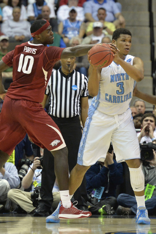 Mar 21, 2015; Jacksonville, FL, USA; Arkansas Razorbacks forward Bobby Portis (10) knocks the ball away from North Carolina Tar Heels forward Kennedy Meeks (3) in the first half of a game in the t ...