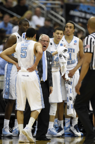 Mar 21, 2015; Jacksonville, FL, USA; North Carolina Tar Heels head coach Roy Williams reacts during a timeout as his team takes on the Arkansas Razorbacks in the second half of a game in the third ...