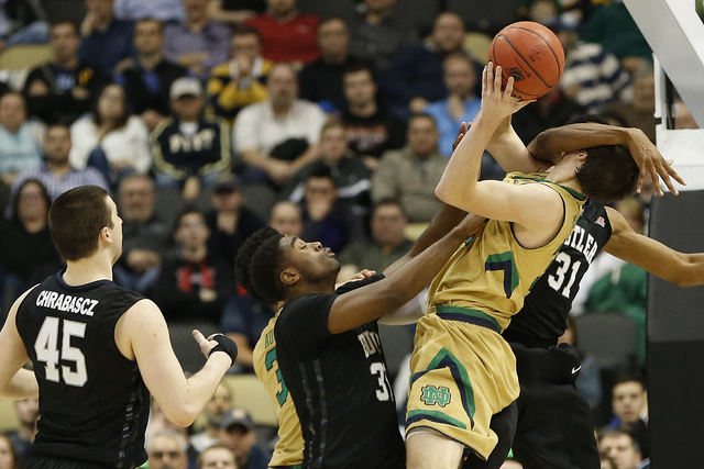 Mar 21, 2015; Pittsburgh, PA, USA; Butler Bulldogs forward Kameron Woods (31) blocks the shot by Notre Dame Fighting Irish guard Steve Vasturia (32) during the second half in the third round of th ...