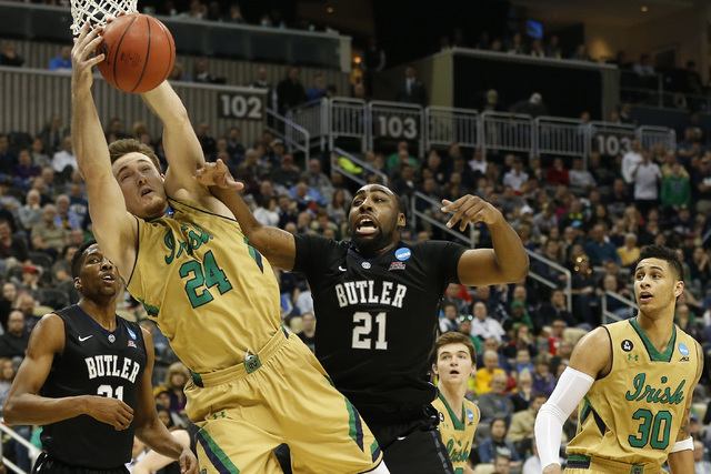 Mar 21, 2015; Pittsburgh, PA, USA; Notre Dame Fighting Irish guard/forward Pat Connaughton (24) battles for a rebound with Butler Bulldogs forward Roosevelt Jones (21) during the second half in th ...