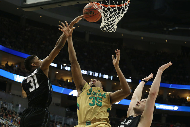 Mar 21, 2015; Pittsburgh, PA, USA; Butler Bulldogs forward Kameron Woods (31) blocks the shot by Notre Dame Fighting Irish forward Bonzie Colson (35) during the second half in the third round of t ...